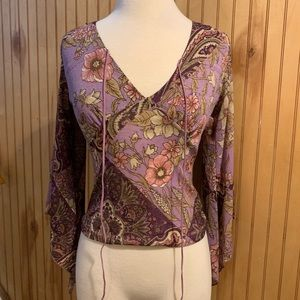 Floral/paisley bell sleeved blouse.
